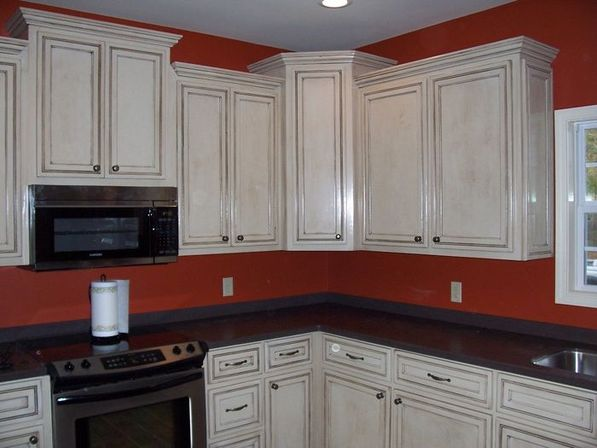 Glazed kitchen cabinets kitchens designs ideas for Antique glazed kitchen cabinets