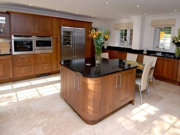 The value of the walnut kitchen cabinets kitchens for Walnut kitchen designs