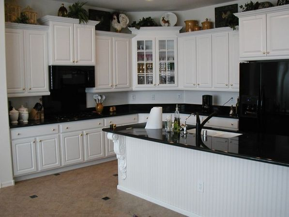 white kitchen cabinets with black countertops | kitchens designs ideas