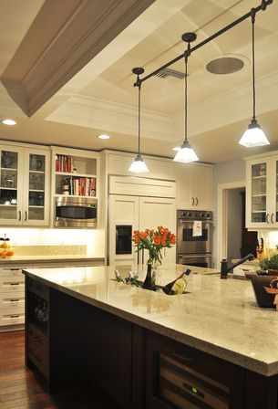 Properly selected lighting will fill the kitchen with light, visually  expand the space and will increase the height of the ceilings.
