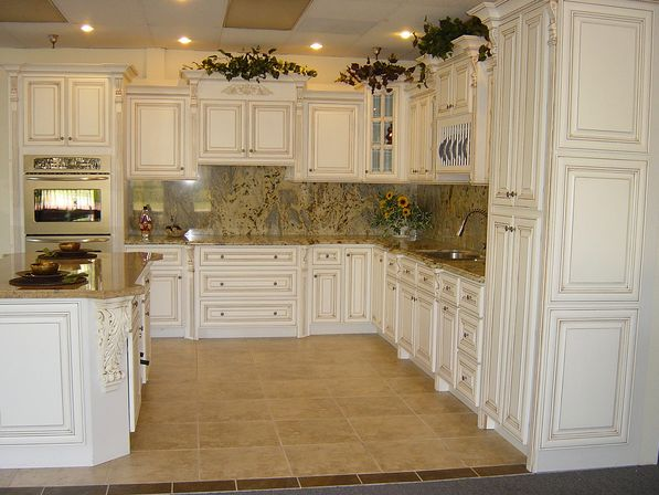 Antique white kitchen cabinets photo kitchens designs ideas for Brown kitchen cabinets with black granite