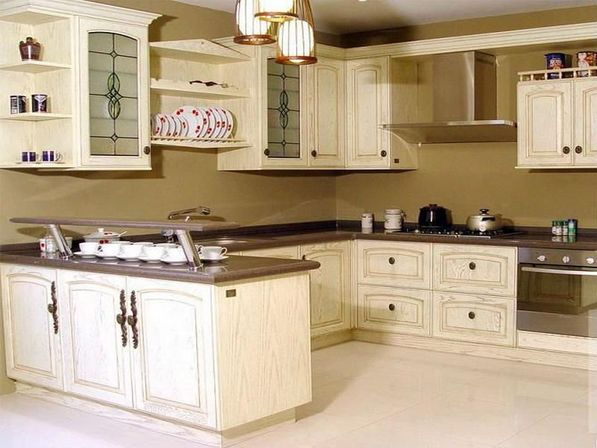 Antique white kitchen cabinets photo kitchens designs ideas for Antique painting kitchen cabinets ideas