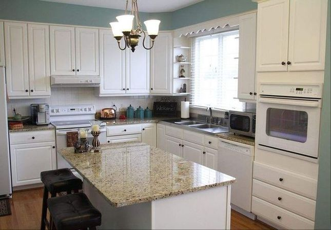 White kitchen cabinets with white appliances, tips and photo