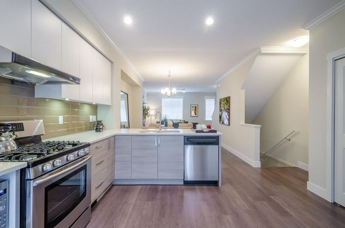 White kitchen cabinets with black countertops, photo