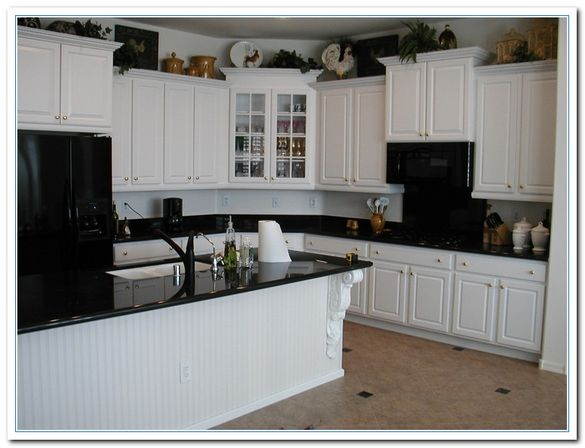 White Kitchen Cabinets And Black Quartz Countertops